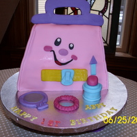 Granddaughter's First Birthday Cake My granddaughter's favorite toy is her Fisher Price purse so we decided this HAD to be her first cake. WASC with Sugarshack's...