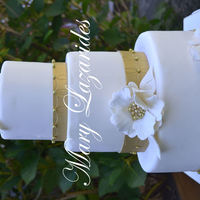 Golden Anniversary Cake This was a golden anniversary cake for a modern couple celebrating 50 years of marriage. I had a lot of fun making the fantasy flowers and...