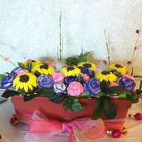Sunflowers And Roses Cupcake bouquet I made for my friends Bridal Shower.Pink velvet cupcakes.