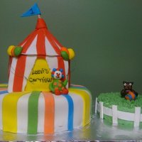 Carn Carnival theme cake for my friends son's first birthday. I like to incorporate smash cakes when I can!