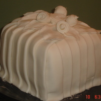 White Pleats A little cake I did to practice pleating....I wanted to see how it would look on a square cake.