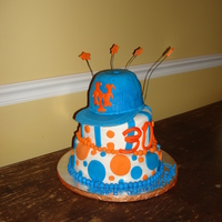 Mets Topsy Turvy Cake I made this cake for a 30th surprise birthday. The cap is gumpaste with fondant. The bottom 2 layers are fondant. The bottom layer is...
