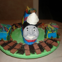 Tommy The Train Cake Made this for a friend's birthday. The train tracks are made of chocolate wafers and piped frosting