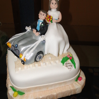 Bmw Wedding Cake fondant. Car and figurines made out of Gum Paste.