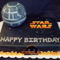 Star Wars  Star Wars cake for a little boy's 5th birthday. Black mmf. Death star made of rice krispy treats and using a sports ball pan. Flames...