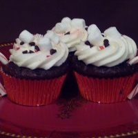 Hot Chocolate Cupcakes Devil's food chocolate cupcakes with vanilla buttercream. Filled with an esspresso truffle filling, topped with crushed candy canes,...