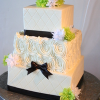 Quilted Rose Wedding Cake All buttercream cake with real ribbons. The couple made paper flowers instead of getting real flowers for the event so we added some of...