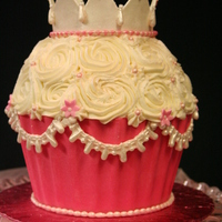 Giant Princess Cupcake This cake was made for a little princess. Colored white chocolate for the shell, rose buttercream for the top. Accents are fondant. Thanks...