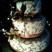 Copper Wedding Cake Fondant with fondant ribbon and royal icing piping. Tfl