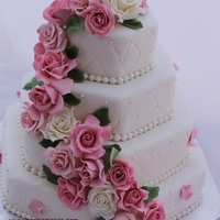 Romantic Wedding Cake Wedding cake covered in marzipan. Roses are made of gumpaste and marzipan.