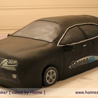 Big Car! Lexus 450h car. Chocolate cake with chocolate butter cream, covered in marzipan. Edible pictures. Made for a car shop owner in Trondheim,...