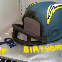 Football Helmet Chargers helmet cake made for my nephew's birthday. First time making this and was guided by several cakes I saw here on CC. Chocolate...