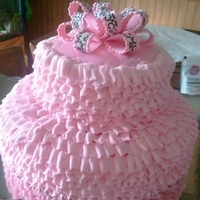Pink Tutu Cake Pink Buttercream Ruffles that make this 2-tiered cake look like a Tutu, topped off with a gumpaste and sugar sheet bow! Designed for Dance...