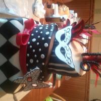 Sweet 16 Masquerade Ball Cake Black and white with a splash of red, slightly topsey turvy, Masquerade Ball theme cake for Sweet 16! Masks are gumpaste and cake is...