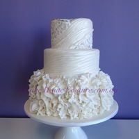 "Wedding Gown Inspired Cake   Textured to resemble the bride's gown. Pearl lustre and silver ""embroidery"""