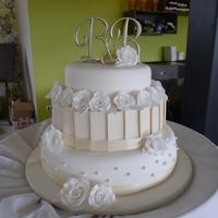 My First Wedding Cake - White & Ivory 3 Tier Wedding Cake With Gumpaste Roses This is my very first wedding cake! The bride wanted a white and ivory three tiers cake, fruit cake, white chocolate mud cake and dark...