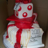 Red And White Graduation   Granduation cake designed by customer. Had fun making this but learned I dont like red fondant!