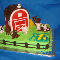 A Birthday On The Farm! Farm themed birthday cake! Barn is cake, carved and iced in buttercream with white fondant decorations. All the animals were made from...