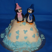 A Penguin Anniversary! The penguins were made from gumpaste! Iced in buttercream with sugar poured on to make it shine a little! Hard to see it the picture though...