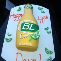 Bud Light Lime Bud Light Lime bottle for my friend's 40th. Vanilla cake with chocolate ganache filling, vanilla BC, fondant accents