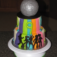 Disco Skate Party Cake this was made for a skate party with a disco theme - disco ball is rice crispy treats covered in fondant , i cut the dancers with my cricut...