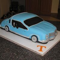 Monte Carlo Tennessee Vols First time making a car cake - its suppose to be a monte carlo , the groom was also a Tennessee Vols fan , the dog in the window is the...