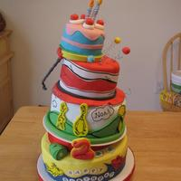Dr Suess Cake got inspiration from this cake from one off the internet - used wiltons sugar sheets to draw the characters on and the stripes on the hat &...
