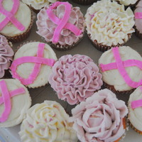 Cancer Ribbon Cuppies   Pink lemonade cupcakes with vanilla frosting for my husband's aunt after her double mastectomy.