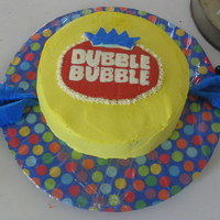 Dubble Bubble   11 inch round dark chocolate cake with marshmallow filling. Vanilla buttercream and mmf wrapper edges. TFL!