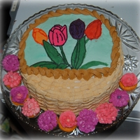 Basket Of Flowers Orange Creamsicle cake with vanilla buttercream. Tulips are a fbct.