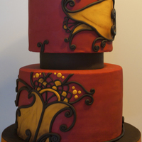 "Henna Inspired Wedding Cake Chocolate cake, chocolate bavarian creme, chocolate ganache covered in fondant.2 x 10"" and 2 x 8"" cakes with an inedible 6""..."