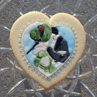 Victorian Kiss Cookie No fail sugar cookie decorated with glaze icing and some hand-painted accents.