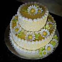 Yellow Daisy Cake White Almond Sour Cream cake with Cream Cheese icing. Daisies and leaves are gumpaste