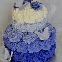 "Purple Ombre Rosette Cake  6"" and 3"" french vanilla cakes with Vanilla/Almond Viva Crusting Buttercream piped into Purple Ombre Rosettes (look blue in..."