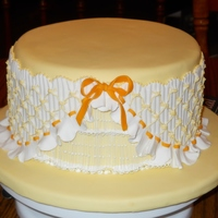 "Yellow Smocked Cake  This cake was so much fun! Wanting to try smocking, I read Cynthia Venn's book, ""Smocking in Sugarpaste"" and..."