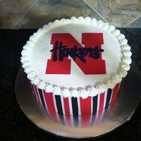 "Nebraska Huskers Birthday Cake 10"" round cake with Viva crusting buttercream and hand cut sugar sheets."