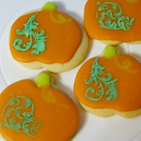 Stamped Pumpkin Cookies  Fell in love with the look of scroll work on pumpkins so tried it on cookies for my son's fall festival class party. No fail sugar...