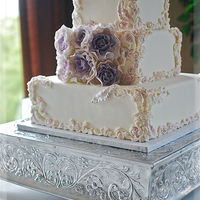 Maggie Austin Inspired Bas-Relief With Sterling Gum Paste Roses A Maggie Austin Cake design with bas-relief roses and scroll work framing the square tiers. Lavender (Sterling) gum paste roses punctuated...