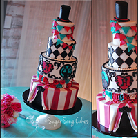 Vintage Circus Wedding Cake This Vintage Circus wedding cake has four tiers, fondant finished in soft white, aqua, deep raspberry, black, and silver. Cake sizes are 12...