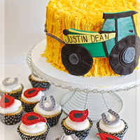 "Tractor And Haybale Cake With Country Cupcakes This is an 8"" centerpiece cake finished in buttercream with a fondant tractor and wire detail. The Birthday Boy's name was on the..."