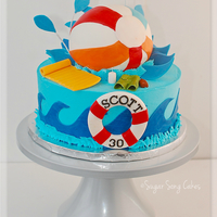 "Pool Party Beach Ball Cake 6"" ball splashing into a 10"" buttercream tier. Fondant covered ball and wired splashes, fondant/gum paste pool float, drink,..."