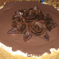 Chocolate Covered Cheesecake Cheesecake (refrigerator not baked) with chocolate ganache covering and candy clay roses. I thought I had run out of chocolate ganache so I...