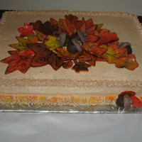 Autumn Leaves Cake Pumpkin Spice cake with cinnamon BC frosting.Leaves made from marbled fondant and handpainted. Acorns were molded coating chocolate.