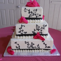 Black, White, & Pink Cake Buttercream cake with black buttercream piping & artificial pink rose petals. Was very nervous about the black bleeding with 88 degrees...