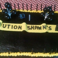 Caution Cake This was a fun easy cake. I made bc icing and died it black. The cake on the inside is yellow and black. The sign is made out of fondant.