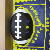 Lsu Birthday Cake All BC on cake, football covered with chocolate fondant with white trim.