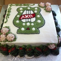 Axo Lyre Cake This was a cake for a sorority fundraiser. AXO colors are olive green and red, their flower is a carnation, and the lyre is one of their...