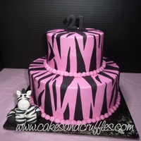 21St Birthday - Hot Pink & Black Zebra Cake Hot Pink buttercream cake with black fondant zebra stripes. I made the fondant/gumpaste zebra on the cake board.