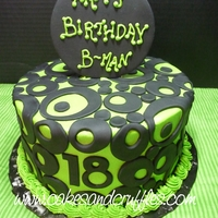 18Th Birthday - Lime Green & Black   Lime Green & Black circle cake. Lime green buttercream with black fondant accents.