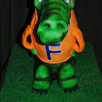 Gator Cake My first 3D cake, my first ever airbrushed cake, I loved how this cake turned out.. Body is cake,, Head and legs rice krispie treats.